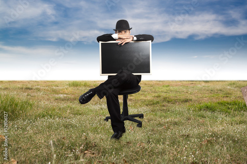 Businessman holding a blackboard.