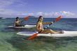 couple paddling surfskis