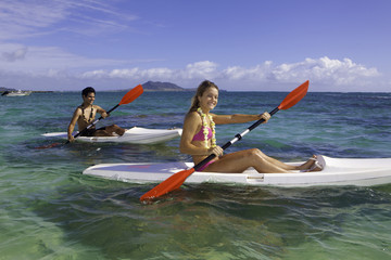 couple paddling surfskis