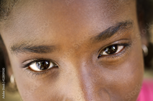 Portrait of happy young african girl looking at camera, smiling