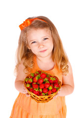 Happy little girl with strawberries