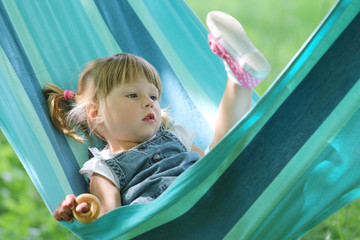 little girl in a hammock