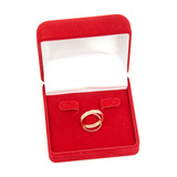 Wedding rings on red box isolated on white