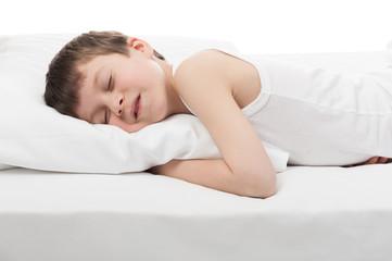 cheerful boy sleep in bed