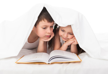 childs read a book in bed
