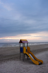 beach with colorful slide