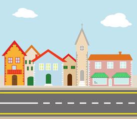 illustrazione di piccolo villaggio attraversato da una strada