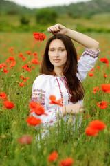 сalm girl in poppes field