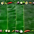 Spices with plumeria.frame.banana leaf background