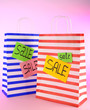 Striped bags on pink background