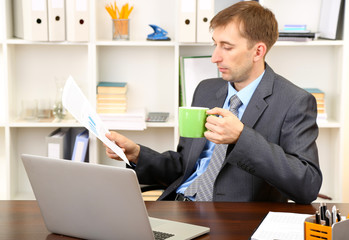Young businessman at lunch break in office