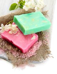 Natural handmade soap on wooden desk, isolated on white