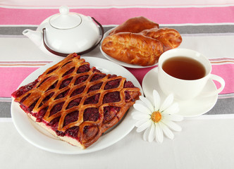 Cherry Pie with tea on table close-up