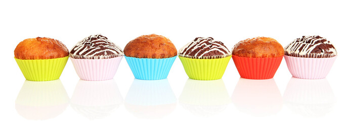 Sweet cupcakes isolated on white