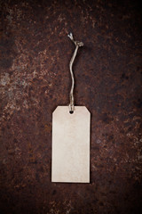 Old tag on grunge background..
