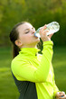 An image of a young girl drinking from a water bottle
