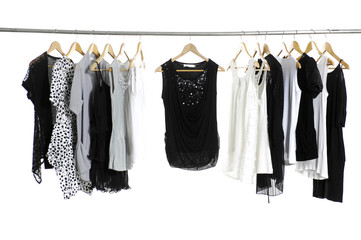 Set of fashion female clothing hanging on hangers