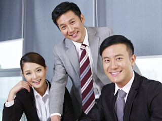 a team of asian business executives