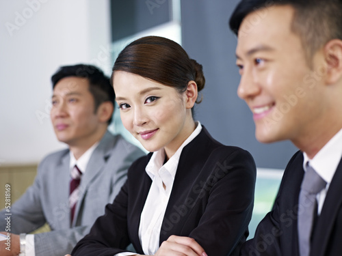 confident asian businesswoman and colleagues