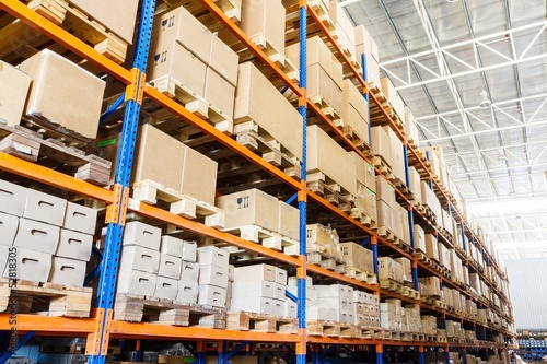 Staande foto Industrial geb. Rows of shelves with boxes in modern warehouse