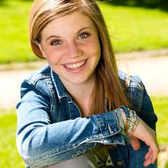 Joyful young girl enjoying sunshine outdoors