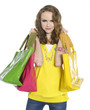 pretty young woman standing with colorful bag posing