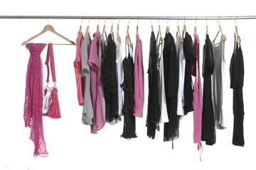 fashion female clothing hanging on hangers