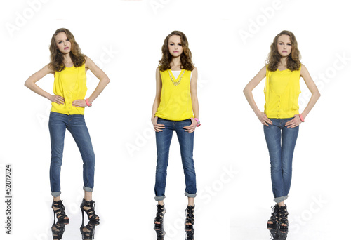 Pretty young woman in stripy shirt and jeans, posing at studio