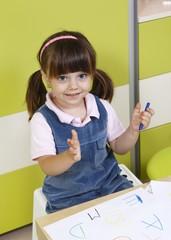Preschool girl learns the alphabet letter