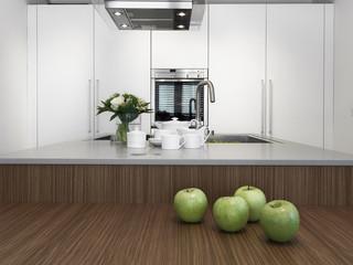 mele verdi e stoviglie sul piano della cucina moderna