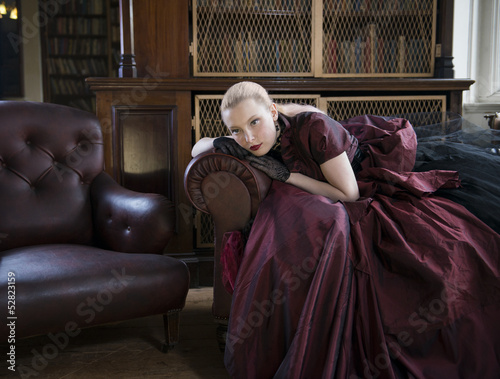 Victorian woman in library
