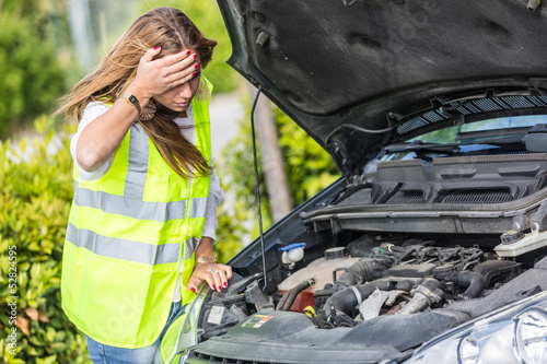 Young Woman with Damaged Car