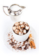 Hot dark chocolate with mini marshmallow, cinnamon and milk in a