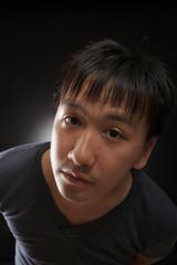 young asian man look at the camera