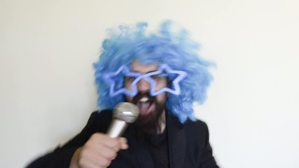 funny bearded man with blue wig singing