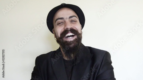 satisfied happy bearded man with hat