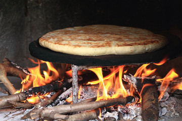 Homemade baked bread in a traditional Turkish Oven