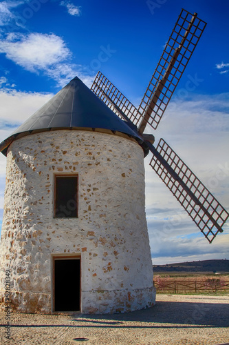 old Windmill XVI century white stone and wood