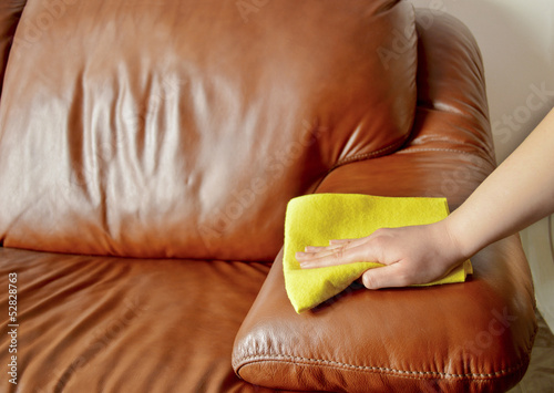 hand wiping couch brown