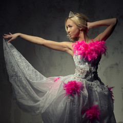 Lovely woman wearing white dress decorated with pink feather boa