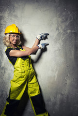 Attractive builder woman showing something with the hands