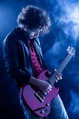 Young Man Playing Electric Guitar