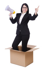 Businesswoman with loudspeaker from the box