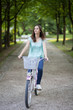 Young woman riding a bike in a park