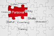 Puzzle in Rot mit Personal