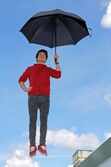 Mann fliegt mit Regenschirm