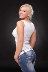 a young blonde wearing jeans and a tank top
