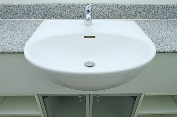 Ceramic handbasin on granite countertop