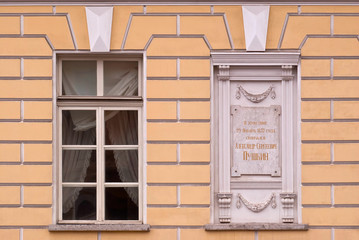 A window with a memorial plate.
