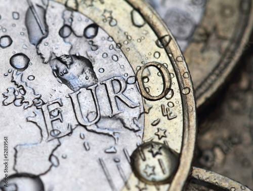 euro coin detail with rain drops